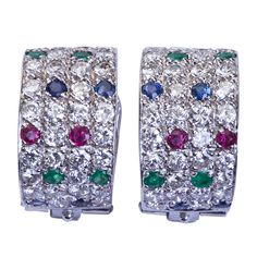 VAN CLEEF & ARPELS Diamond & Colored Gem Ear Clips. France  20th Century  A pair of white gold domed earrings set with diamonds, sapphires, emeralds, and rubies by Van Cleef & Arpels contains ~2.15cts of diamonds. Signed and numbered with certificate of authenticity. - for sale at 12k$