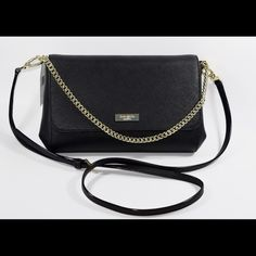 """NWT Kate Spade Newbury Lane Greer Purse NWT Kate Spade Black Newbury Lane Greer. Can be worn three ways - shoulder with chain, crossbody or as a clutch. Made of Saffiano leather and light gold tone hardware. Flap top with magnetic closure, lined interior with zip pocket and one open pocket. 6.5x12x2 w/ 22"""" cross body adjustable strap and 6.25"""" chain drop. No trades Final price unless bundled kate spade Bags"""