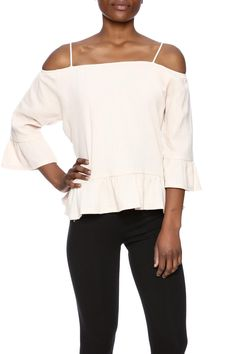 Light and drapey off the shoulder top, featuring ruffle hem, adjustable straps and stretch banding. 3/4 sleeves with a swingy fit. Off Shoulder Ruffle Top by Babel Fair. Clothing - Tops - Blouses & Shirts Williamsburg, Brooklyn, New York City