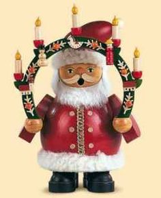 Wooden Angels, Hand Carved Santas, Pyramids that Spin with lit Candles, Glass Ornaments, Advent Wreaths, Nutcrackers and Smokers are all traditional German decorations.