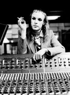 "brian eno.  In his Roxy Music days.  Every now and then I just have to listen to ""Baby's on Fire""."