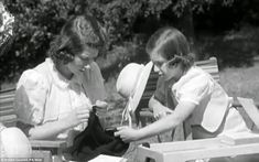Princesses at play: The young pair look intent on their task as they work on the knitting together. Elizabeth