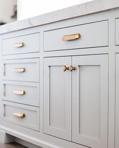 Grey kitchen cabinets with gold drawer pulls // kitchen decor ideas kitchen design cabinet hardware kitchen hardware neutral kitchen feminine kitchen Grey Kitchen Cabinets, Kitchen Cabinet Hardware, Kitchen Redo, Kitchen And Bath, New Kitchen, Kitchen Makeovers, Kitchen Upgrades, Inset Cabinets, Kitchen Remodeling