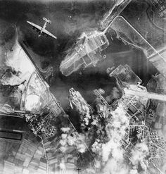 A B-24 Liberator during a daylight attack on the port of Monfalcone, #Italy. #WWII #History #WW2 #war #wars #europe #italian #plane #planes #air #raid #bomb #bombing #pilot #1940s #veteran #veterans #worldwar2 #worldwarii