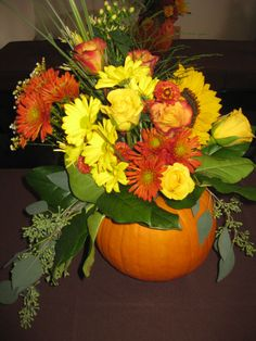 Rehearsal dinner table centerpieces. Made by a family member. Great fall idea!
