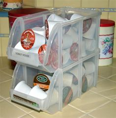 Medium storage bin : find at Staples. Great for storing Kcups in our camper cabinet and they stack to save space. Our Staples had only black ones, for $3.99 each