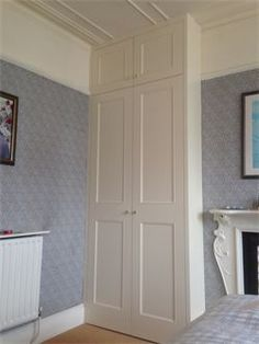 Fully fitted period/traditional style wardrobe, with cream white satin finish