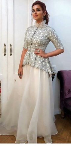 Parineeti style Peplum Top With Organza Skirt Source by dussaanu # Casual Outfits indian bridal lehenga Sharara Designs, Lehenga Designs, Saree Blouse Designs, Indian Fashion Dresses, Indian Gowns Dresses, Indian Designer Outfits, Indian Outfits, Designer Dresses, Funky Dresses