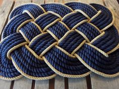 "Navy & Gold Soft Cotton Rope Bathmat 23 x 16"" Knotted Hand Woven Nautical Coastal Beach Rope Rug by AlaskaRugCompany on Etsy https://www.etsy.com/listing/230030195/navy-gold-soft-cotton-rope-bathmat-23-x"