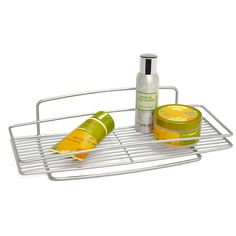 This tray can be used on the top of a toilet tank for more storage space.