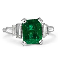 A stunning one-of-a-kind emerald and diamond vintage engagement ring.