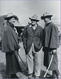 SHE WORE A YELLOW RIBBON (1949) - John Wayne, director John Ford  Ben Johnson on location in Monument Valley, Utah - Directed by John Ford - RKO-Radio - Production Still.