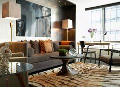 modern chic masculine living room design silver wallpaper covering tiger carpet orange brown | theLENNOXX