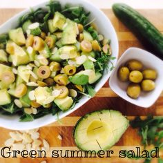 Healthy and delicious summer salad with avocado, olives cucumbers aragula and almonds !