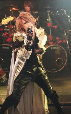 Kamijo. Same man shorter hair. Still a handsome man!~ And that voice....that voice...