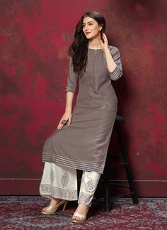 Be an angel and create a smashing impact on everyone by wearing this grey cotton party wear kurti. The lovely fancy work throughout the attire is awe inspiring. Plain Kurti Designs, Salwar Designs, Kurti Neck Designs, Kurta Designs Women, Kurti Designs Party Wear, Blouse Designs, Indian Designer Outfits, Designer Dresses, Indian Outfits