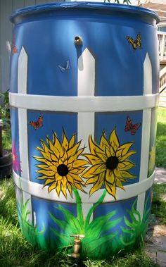 paint rain barrels for yard... Krylon Fusion spray paint for base, then acrylic for design: