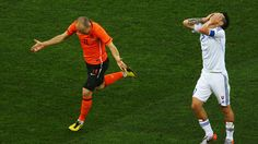 DURBAN, SOUTH AFRICA - JUNE 28: Arjen Robben of the Netherlands celebrates scoring the opening goal as Marek Hamsik of Slovakia (L) looks dejected during the 2010 FIFA World Cup South Africa Round of Sixteen match between Netherlands and Slovakia at Durban Stadium on June 28, 2010 in Durban, South Africa. (Photo by Quinn Rooney - FIFA/FIFA via Getty Images)