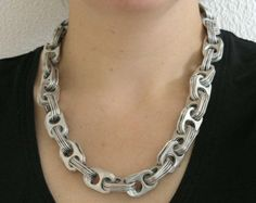 Pop tabs have been cleaned and smoothed for comfort. Aluminum from the pop tabs gives this necklace a beautiful shine. Soda Tab Crafts, Can Tab Crafts, Tape Crafts, Bijoux Wire Wrap, Bijoux Diy, Jewelry Crafts, Handmade Jewelry, Unique Jewelry, Kumihimo Bracelet