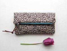Liberty fabric zip pouch/clutch/foldover clutch/cosmetic bag. YKK brass zip. Leather puller. on Etsy, $34.93