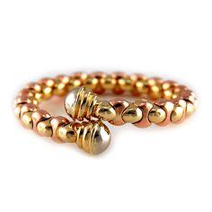 Rose, White, & Yellow Gold Cuff Bracelet Rose and yellow cuff style bracelet with white gold ends, all in 14 karat gold.   42.51 grams