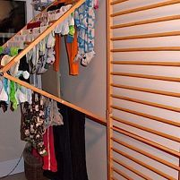 DIY Wall-Mounted Clothes Drying Rack repurposed from a wooden baby safety gate system.