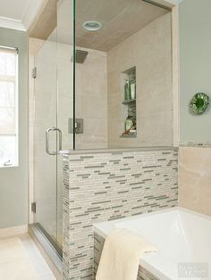 Half-wall to give small bathroom illusion of more space.