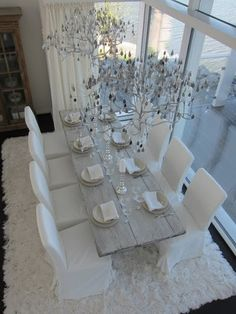 old table, white chairs, water view-wow