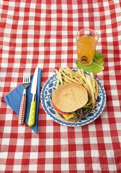 Clever coasters and mismatched retro patterns will transform your table into an unforgettably stylish picnic.