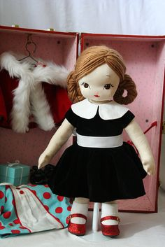 """""""Christmas doll, Noelle"""" and her wardrobe, by Jill Hamor (a.k.a. bybido) as a gift for her 5-1/2 year old daughter. This image on the artist's Flickr.com feed; more pictures and ideas at her blog, http://bybido.blogspot.com/2010/12/for-sweet-little-girl.html, and in her book, """"Storybook Toys: Sew 16 Projects from Once Upon a Time Dolls, Puppets, Softies & More,"""" ©2012."""