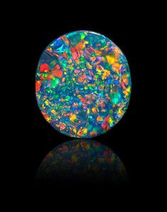 """Lot 3149 FINE BLACK OPAL, 10.93ct. Sold for US$ 56,250 inc. premium THE WORLD OF GOLD, OPALS AND OTHER """"PHENOMENAL"""" GEMS 15 May 2018"""