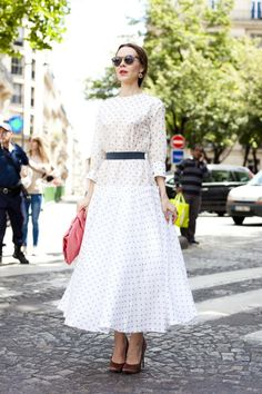 Ulyana Sergeenko in Ulyana Sergeenko polka dot dress and Prada hot pink clutch.  She is one of the chicest ladies on the streets. Love her elegance.