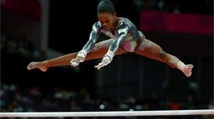 Gabrielle Douglas competing for Gold in the women's Uneven Bars