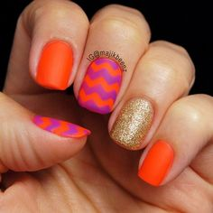 "Nails - Neon chevron mani using Essie ""Saturday Disco Fever"" (orange) and ""DJ Play That Song"" (purple), and butter London ""West End Wonderland"" glitter and ""Matte Finish"" topcoat. --- Instagram @majikbeenz"