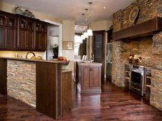 Kitchen.  Stone on island, backsplash, and in the bay window.  Dark finish on cabinets.