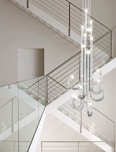 lighting for hallways and landings. This Stunning Contemporary Chandelier Lighting Installation Design Features Curling Glass Tubes. For Hallways And Landings
