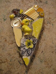 """Tiny duckling heart mosaic plaque, mosaic art. If by """"art"""" you mean """"melt a bunch of random shot together""""."""