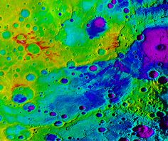 "Using colorized topography, Mercury's ""great valley"" (dark blue) and Rembrandt impact basin (purple, upper right) are revealed in this high-resolution digital elevation model merged with an image mosaic obtained by NASA's MESSENGER spacecraft."