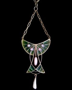 This is not contemporary - image from a gallery of vintage and/or antique objects. LEVINGER & BISSINGER A silver, plique-a-jour, pendant, set opals with pearl drop.