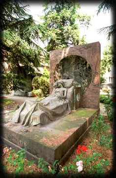 This is a most touching and telling cemetery statue. Sad, yes, but conveying her desire that you know that she is not dead, but just asleep and in peace. Monumentale Cemetery, Milan, Italy