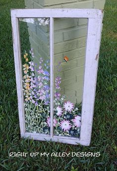 This 2 pane Window art is painted with one of my favorite flowers, foxgloves and other garden gems. I imagine it would be beautiful in a shabby chic decor for one. This is a piece of ART, NOT A WINDOW TO BE WASHED! These are no work windows~~ Feather dust only. Measurements: 20