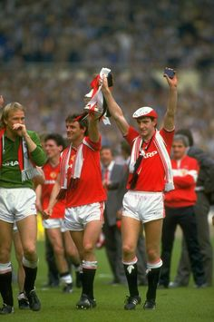 May 1985: Norman Whiteside and Kevin Moran of Manchester United hold the trophy aloft after the FA Cup final against Everton at Wembley Stadium in London. Manchester United won the match 1-0. Mandatory Credit: David Cannon/Allsport