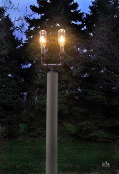 Pole  Lamp. Beer bottles, Plumbing pipe & fittings. Wall lamp. Lighting Fixture. via Etsy