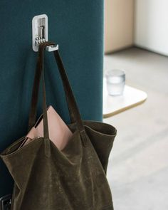 Mote has been designed to provide a holistic solution when designing dynamic environments. Mote has been completed with clever solutions such as coat hooks and sockets for charging any mobile device. Coat Hooks, Bucket Bag, Clever, Interior, Bags, Furniture, Design, Indoor, Handbags