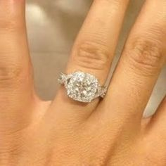 "Cushion style halo engagement ring with ""infinity"" band. A sparkler! -- repinned by bridesandrings.com"