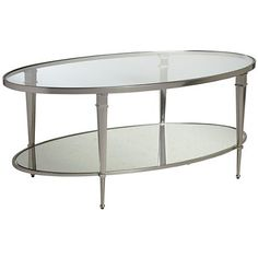 A gleaming nickel finish and antiqued mirrored glass give this oval cocktail table its distinctive style.