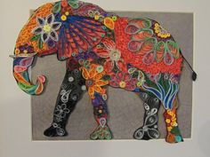 Quilled Elephant. This is a festive colored elephant in a 11x 14 inch black frame with a lighter background that shows off the bright colors of the artwork. This piece would look great in any home. A real conversation piece. This item can be placed in a shadow box frame for an additional cost