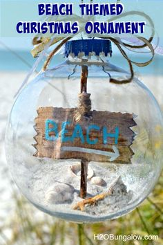 DIY beach themed Christmas tree ornament with sea shells, sand and starfish on the inside.  Plus a quick tutorial on how to get the sign stuffed into the ornament!  www.H2OBungalow.com