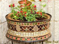 Mosaic pot from wheel rim. Site is in Russian, but the pictures are easy to follow.