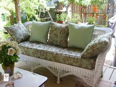 Antique wicker sofa with new cushion made with Sunbrella Merritt Mint fabric. The throw pillows are made with Sunbrella Merritt Mint and Sunbrella Celadon.